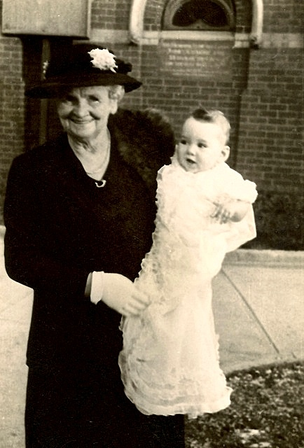 Graeme Douglas in the arms of Grandma Douglas his Christening, in Footscray, in 1946.